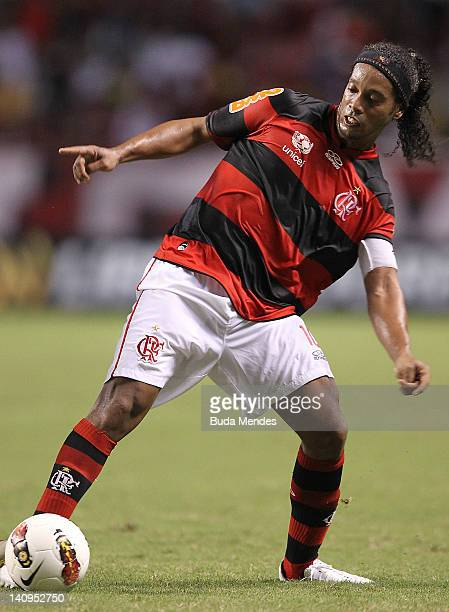 Ronaldinho of Flamengo struggles for the ball during a match between Flamengo and Emelec as part of Santander Libertadores Cup 2012 at Engenhao...