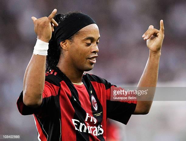 Ronaldinho of Milan celebrates after scoring the opening goal during the TIM preseason tournament at Stadio San Nicola on August 13 2010 in Bari Italy