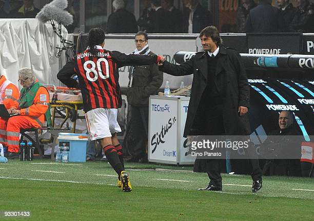 Ronaldinho of Milan celebrates with head coach of Milan Leonardo after scoring the fourth goal during the Serie A match between Milan and Cagliari at...