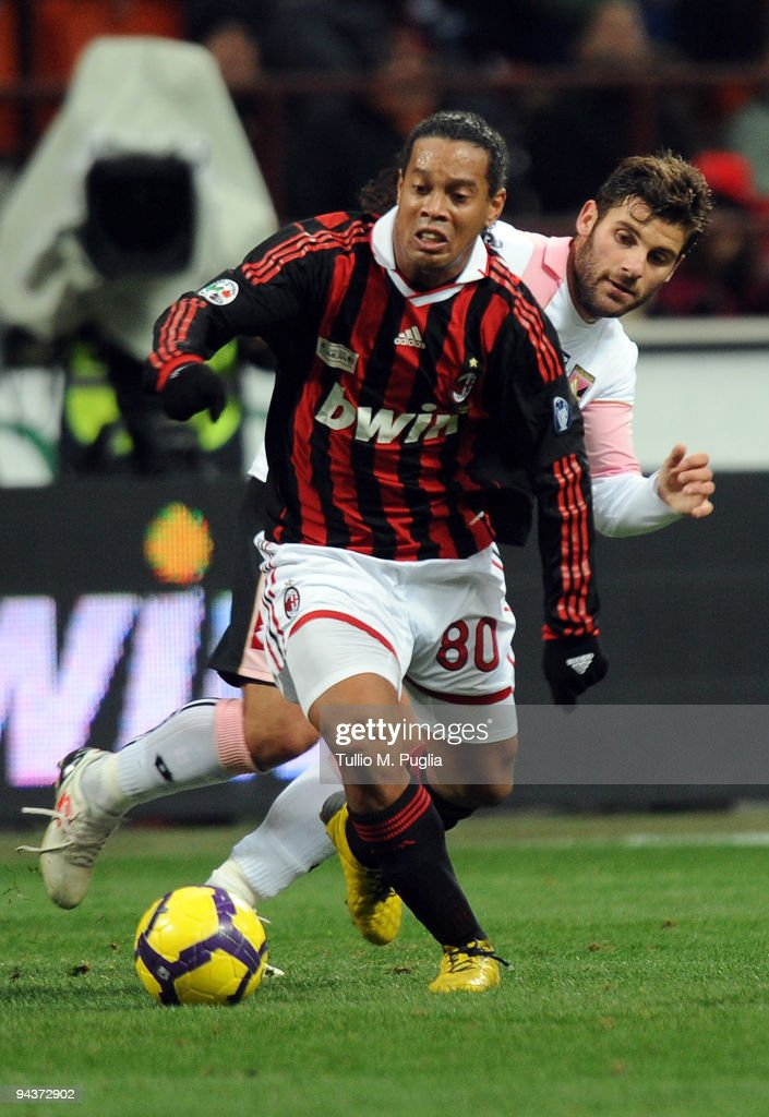 <a gi-track='captionPersonalityLinkClicked' href=/galleries/search?phrase=Ronaldinho&family=editorial&specificpeople=202667 ng-click='$event.stopPropagation()'>Ronaldinho</a> (L) of Milan holds off the challenge fron <a gi-track='captionPersonalityLinkClicked' href=/galleries/search?phrase=Antonio+Nocerino&family=editorial&specificpeople=675969 ng-click='$event.stopPropagation()'>Antonio Nocerino</a> of Palermo during the Serie A match between AC Milan and US Citta di Palermo at Stadio Giuseppe Meazza on December 13, 2009 in Milan, Italy.
