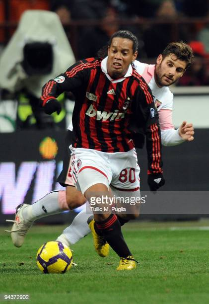 Ronaldinho of Milan holds off the challenge fron Antonio Nocerino of Palermo during the Serie A match between AC Milan and US Citta di Palermo at...