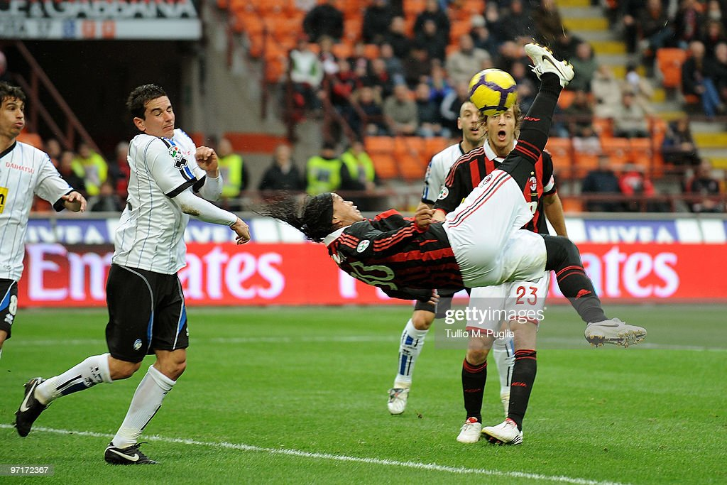 <a gi-track='captionPersonalityLinkClicked' href=/galleries/search?phrase=Ronaldinho&family=editorial&specificpeople=202667 ng-click='$event.stopPropagation()'>Ronaldinho</a> of Milan kicks the ball during the Serie A match between Milan and Atalanta at Stadio Giuseppe Meazza on February 28, 2010 in Milan, Italy.