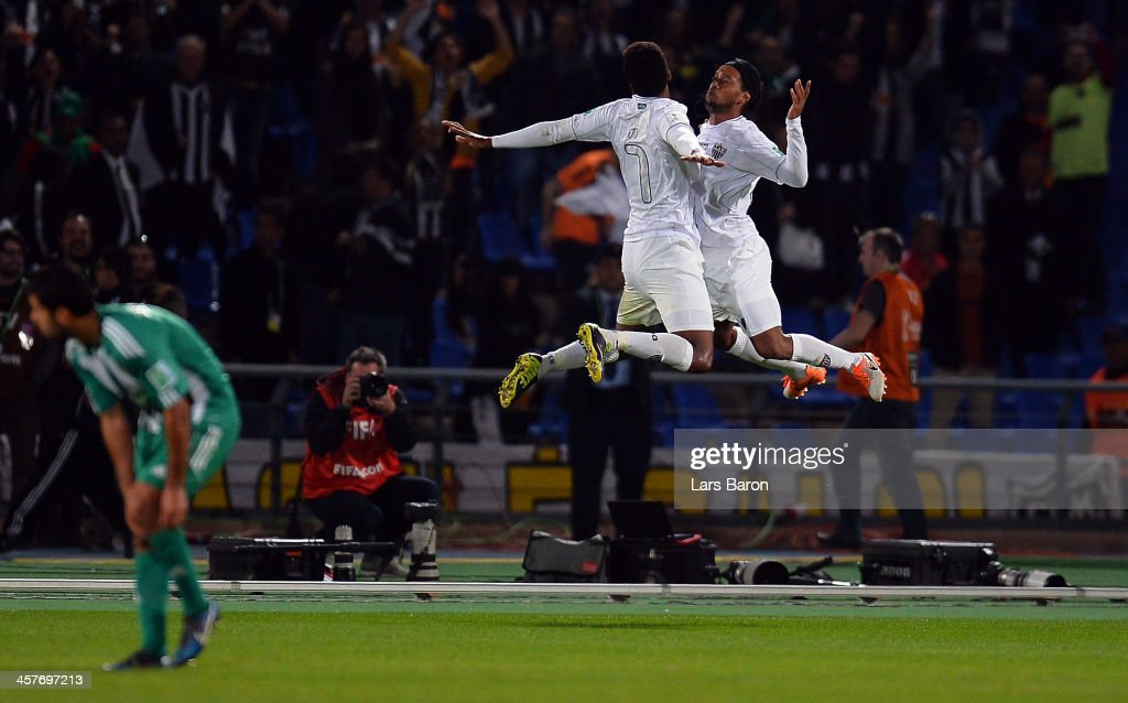<a gi-track='captionPersonalityLinkClicked' href=/galleries/search?phrase=Ronaldinho&family=editorial&specificpeople=202667 ng-click='$event.stopPropagation()'>Ronaldinho</a> of Mineiro celebrates after scoring his teams first goal during the FIFA Club World Cup Semi Final match between Raja Casablanca and Atletico Mineiro at Marrakech Stadium on December 18, 2013 in Marrakech, Morocco.
