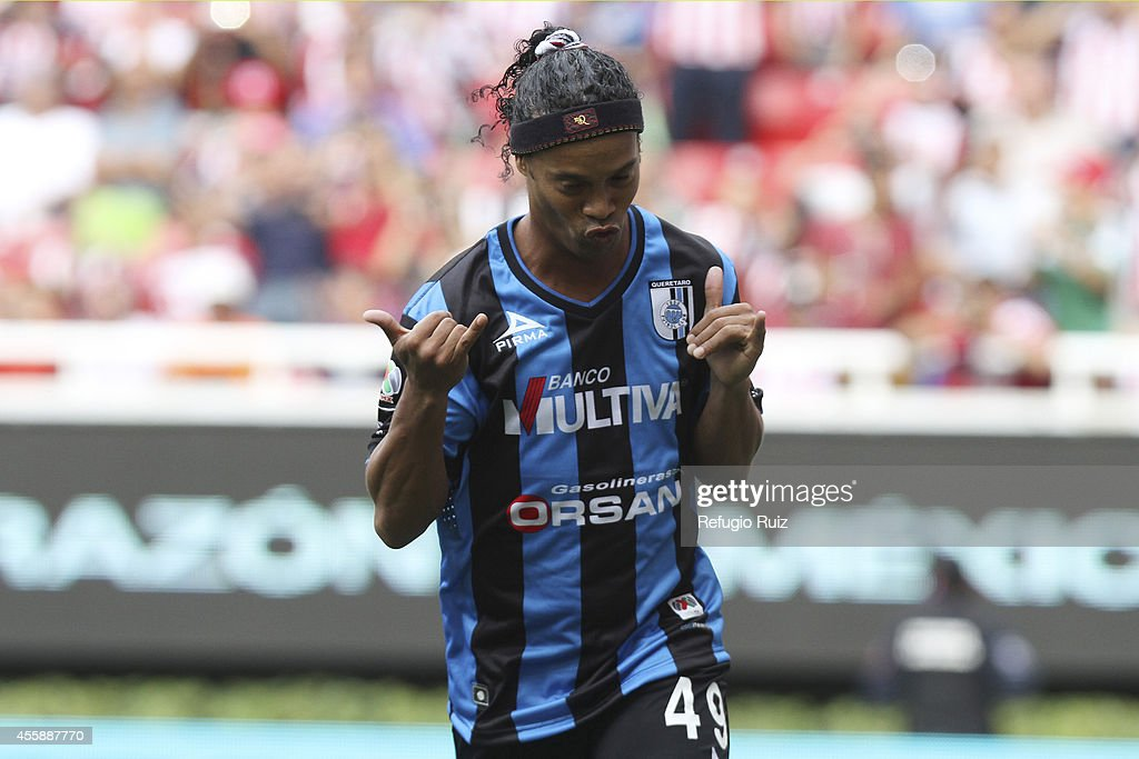 <a gi-track='captionPersonalityLinkClicked' href=/galleries/search?phrase=Ronaldinho&family=editorial&specificpeople=202667 ng-click='$event.stopPropagation()'>Ronaldinho</a> of Queretaro celebrates after scoring the opening goal from the penalty spot during a match between Chivas and Queretaro as part of 9th round Apertura 2014 Liga MX at Omnilife Stadium on September 21, 2014 in Guadalajara, Mexico.