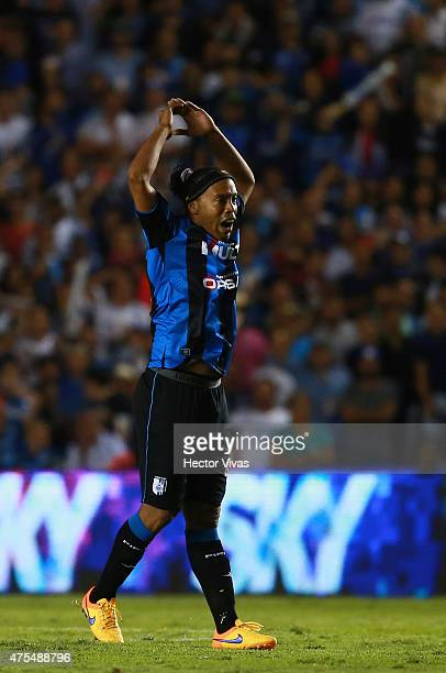 Ronaldinho of Queretaro encourages fans during a championship second leg match between Queretaro and Santos Laguna as part of Clausura 2015 Liga MX...