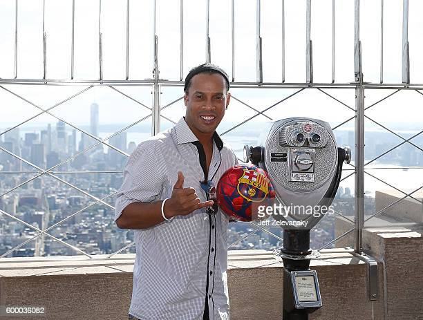 Ronaldinho poses for a picture on the 86th Floor of the Empire State Building to celebrate FC Barcelona's 10year global partnership with UNICEF and...