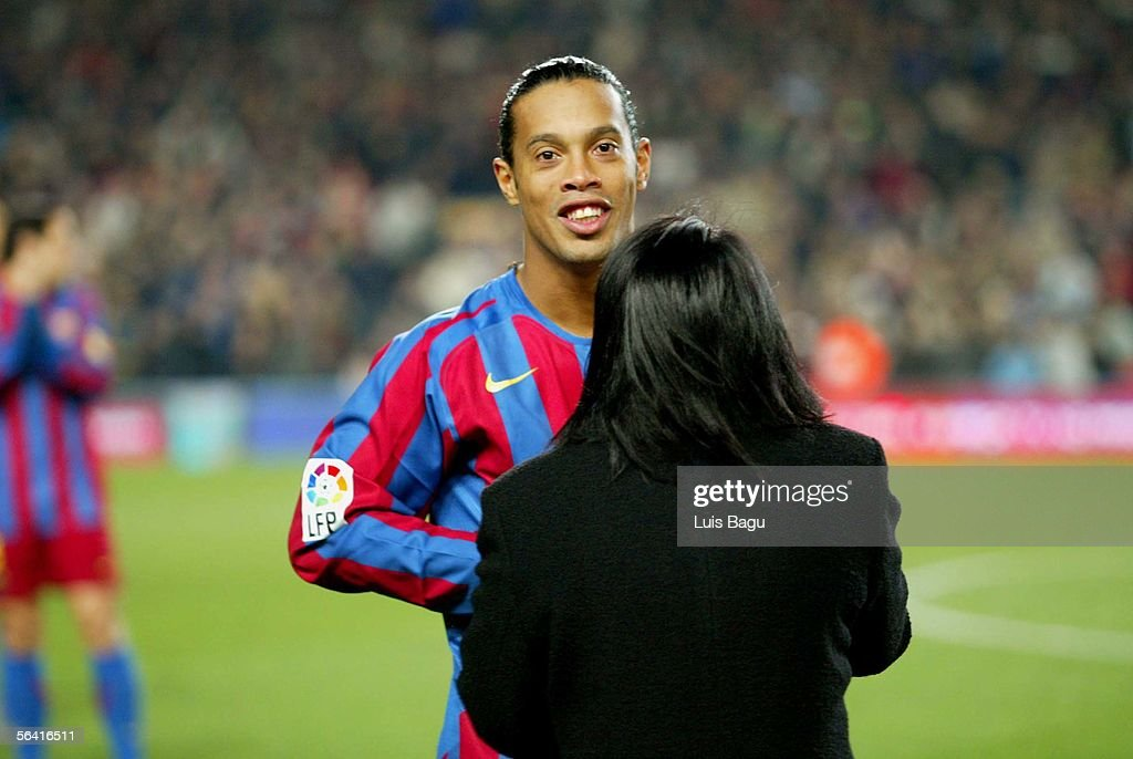 Ronaldinho spends time with his mother before the Primera Liga match between FC Barcelona and Sevilla on December 11, 2005 at the Camp Nou stadium in Barcelona, Spain.