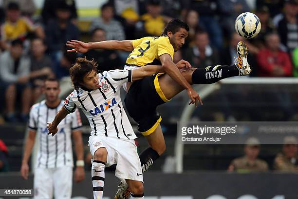 Ronaldo Alves of Criciuma try to take the ball before Romero of Corinthians during a match between Criciuma and Corinthians as part of Campeonato...