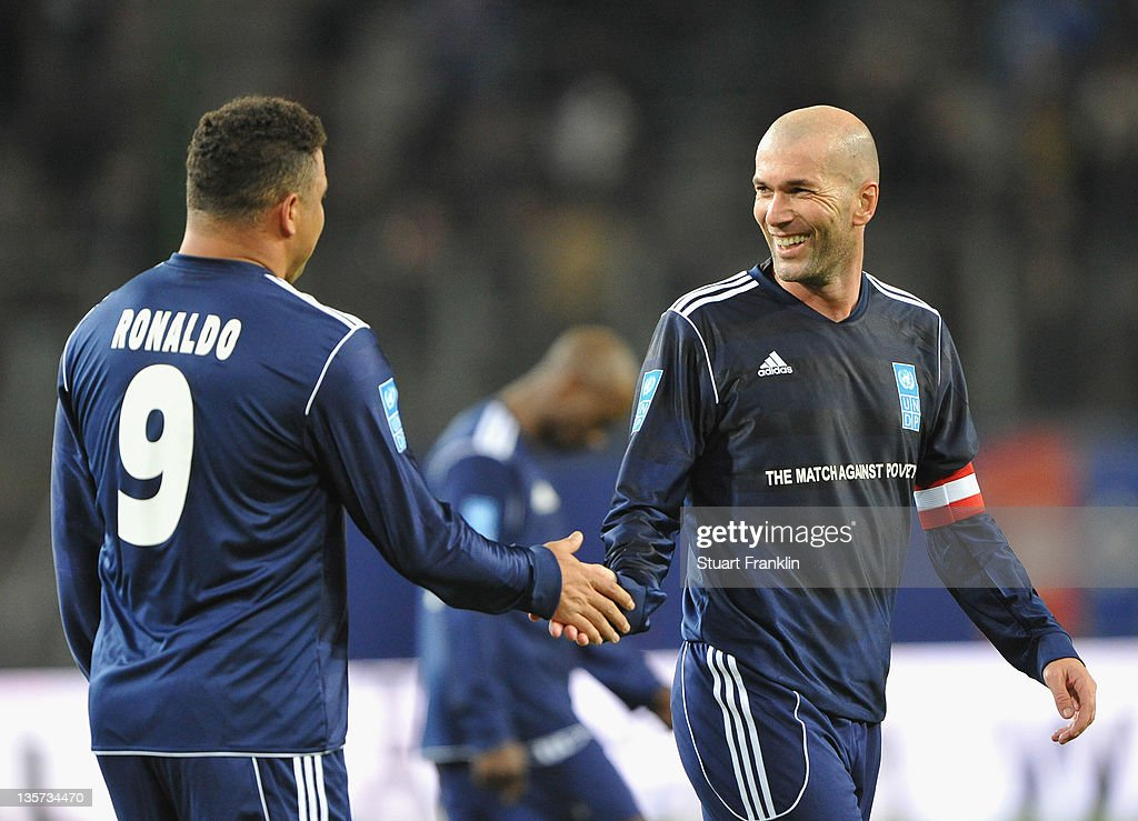 Ronaldo and <a gi-track='captionPersonalityLinkClicked' href=/galleries/search?phrase=Zinedine+Zidane&family=editorial&specificpeople=172012 ng-click='$event.stopPropagation()'>Zinedine Zidane</a> of the friens team clap hands during the charity Match Against Poverty between HSV Allstars v Ronaldo, Zidane & Friends at the Imtech Arena on December 13, 2011 in Hamburg, Germany.