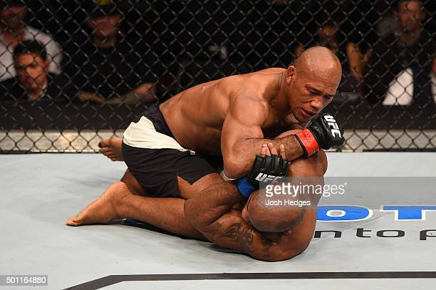 Ronaldo 'Jacare' Souza of Brazil elbows Yoel Romero of Cuba in their middleweight bout during the UFC 194 event inside MGM Grand Garden Arena on...