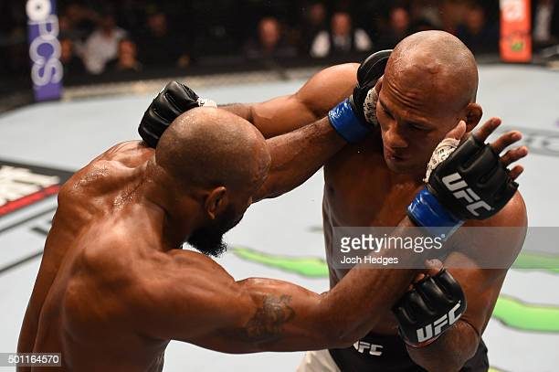 Ronaldo 'Jacare' Souza of Brazil punches Yoel Romero of Cuba in their middleweight bout during the UFC 194 event inside MGM Grand Garden Arena on...