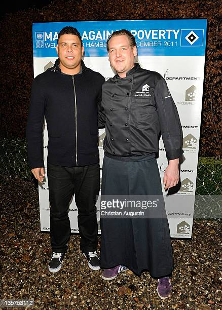Ronaldo Luis Nazario de Lima and chef Patrick Voeltz attend the After Match Dinner of 'Match against Poverty' at the Restaurant 'Das weisse Haus' on...