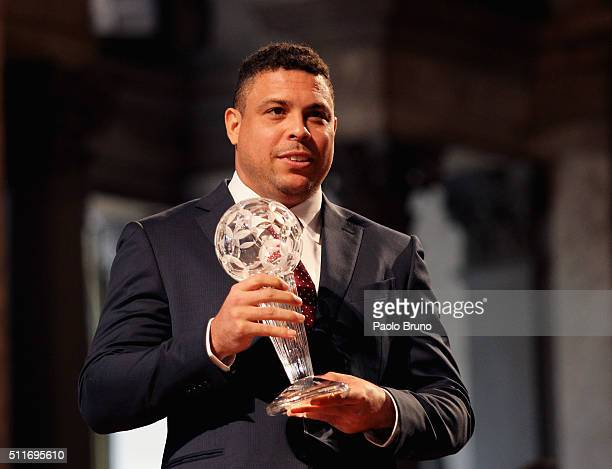 Ronaldo Luis Nazario de Lima poses showing the award during the Italian Football Federation Hall of Fame Award ceremony at Palazzo Vecchio on...