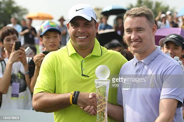 Ronaldo Nazario of Brazil shakes hands with Stephen Hendry of Scotland during day one of the Mission Hills Star Trophy at the Mission Hills Golf Club...