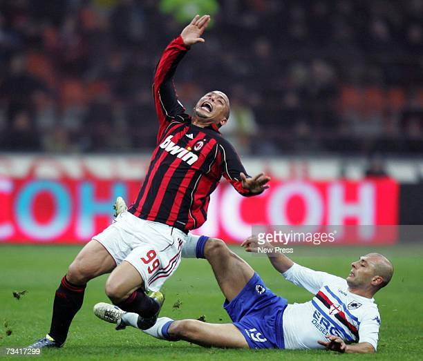 Ronaldo of AC Milan is brought down by Giulio Falcone of Sampdoria during the Serie A match between AC Milan and Sampdoria at the Stadio Giuseppe on...