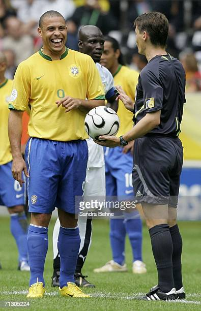 Ronaldo of Brazil enjoys a joke with Referee Lubos Michel of Slovakia during the FIFA World Cup Germany 2006 Round of 16 match between Brazil and...