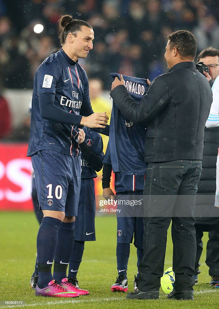 Ronaldo of Brazil kicks off the match and receives a PSG jersey from Zlatan Ibrahimovic before the French Ligue 1 match between Paris Saint Germain FC and Olympique de Marseille at the Parc des Princes stadium on February 24, 2013 in Paris, France.