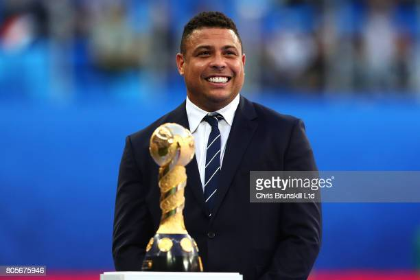 Ronaldo of Brazil looks on next to the trophy ahead of the FIFA Confederations Cup Russia 2017 Final match between Chile and Germany at Saint...