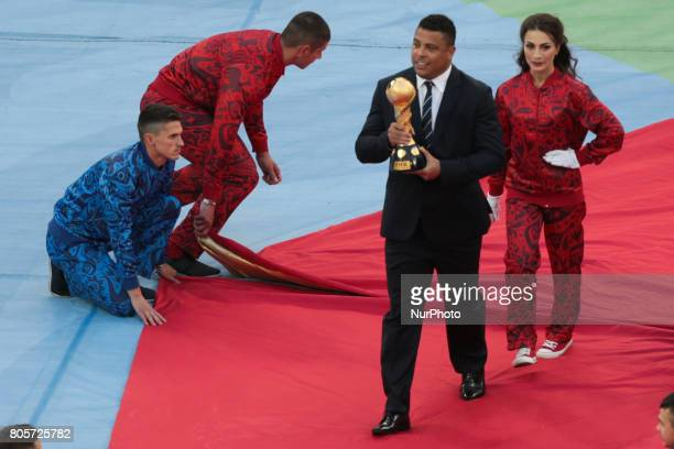 Ronaldo of Brazil presents the FIFA World Cup Trophy to the crowd during the FIFA Confederations Cup Russia 2017 Final match between Chile and...