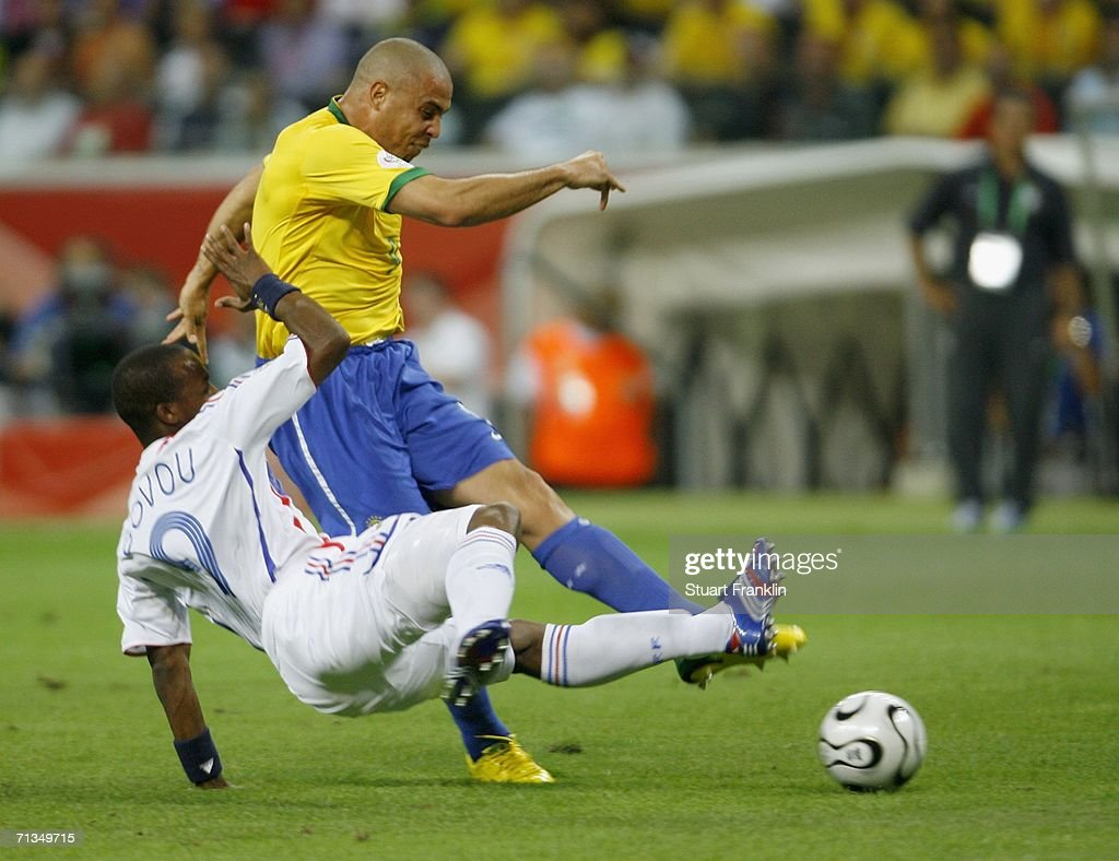 Ronaldo of Brazil shoots on goal, as he is challenged by <a gi-track='captionPersonalityLinkClicked' href=/galleries/search?phrase=Sidney+Govou&family=editorial&specificpeople=242983 ng-click='$event.stopPropagation()'>Sidney Govou</a> of France during the FIFA World Cup Germany 2006 Quarter-final match between Brazil and France at the Stadium Frankfurt on July 1, 2006 in Frankfurt, Germany.