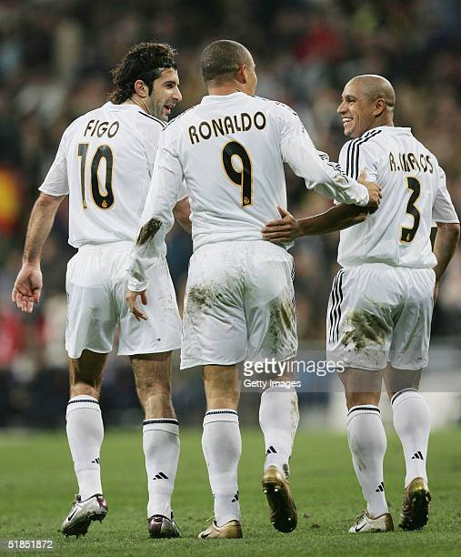 Ronaldo of Real Madrid celebrates with Luis Figo and Roberto Carlos after scoring a goal against Real Sociedad during a Real Madrid v Real Sociedad...