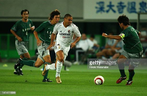 Ronaldo of Real Madrid competes for the ball against Atsushi Yoneyama and Lee GangJin of Tokyo Verdy 1969 during the preseason friendly match between...
