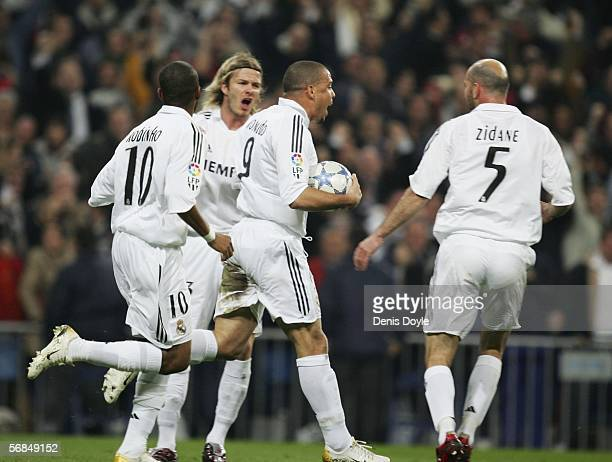 Ronaldo of Real Madrid is mobbed by teammates Robinho David Beckham and Zinedine Zidane after scoring a goal during the Copa del Rey semifinal second...