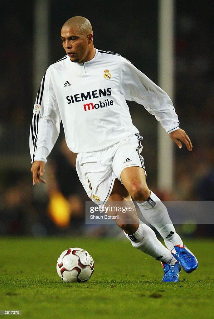 Ronaldo of Real Madrid running with the ball during the Spanish Primera Liga match between Barcelona and Real Madrid on December 6, 2003 at the Nou Camp Stadium in Barcelona, Spain. Real Madrid won the match 2-1.