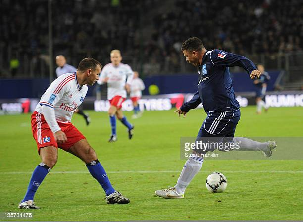 Ronaldo of the friends team challenges for the ball with Michael Gravgaard of the HSV team during the charity Match Against Poverty between HSV...