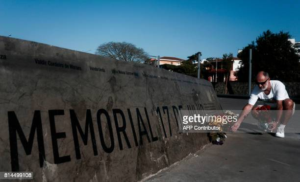 Ronaldo Silva father of Madalena Silva one of the victims of the TAM JJ 3054 flight tragedy places flowers at the memorial across Congonhas airport...