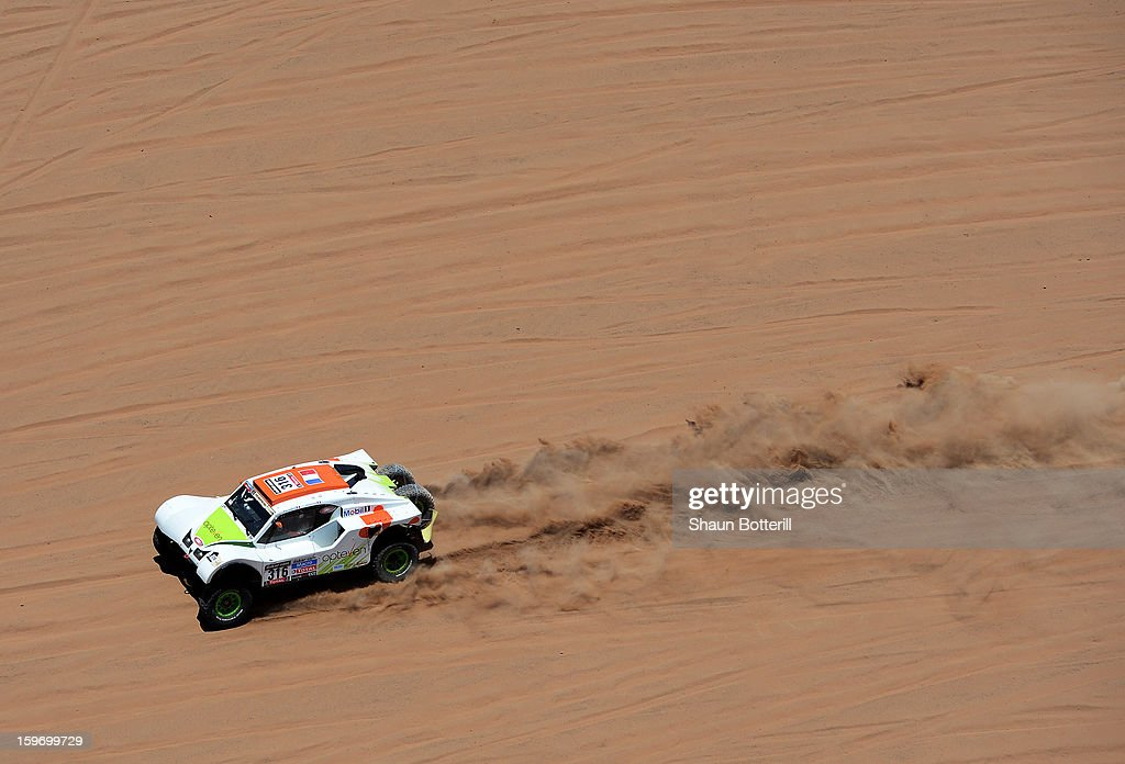 Ronan Chabot and co-driver Gilles Pillot of team SMG compete in stage 13 from Copiapo to La Serena during the 2013 Dakar Rally on January 18, 2013 in Copiapo, Argentina.