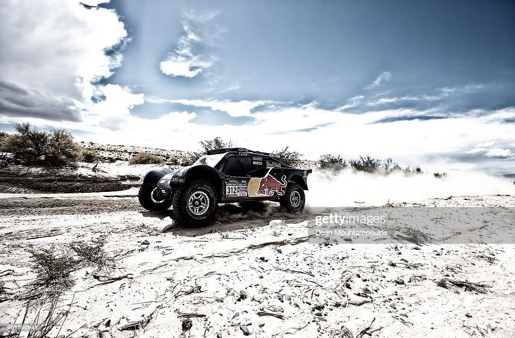 Ronan Chabot and Gilles Pillot of France for SMG Buggy Red Bull Rally Team compete during Day 5 of the 2014 Dakar Rally on January 9, 2014 in San Jose, Argentina.