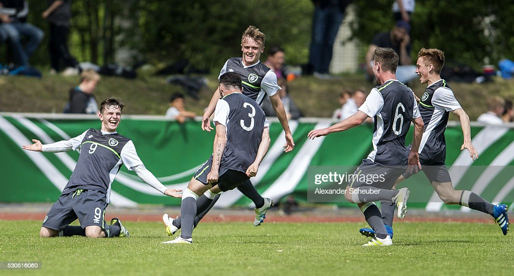 Ronan Hale of Ireland celebrates the second goal for his team with JJ Lunney of Ireland and Robbie McCourt of Ireland during the international...