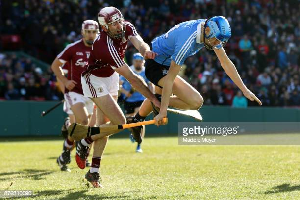 Ronan Hayes of Dublin trips over Padraic Mannion of Galway during the 2017 AIG Fenway Hurling Classic and Irish Festival at Fenway Park on November...