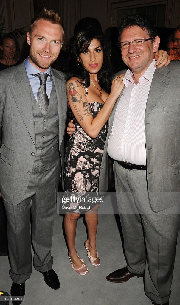 Ronan Keating, Amy Winehouse, and Lucian Grainge attend the Lucian Grainge VIP Party on June 15, 2010 in London, England.