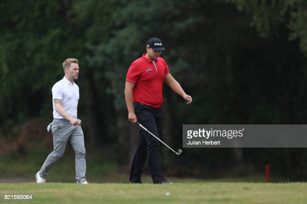 Ronan Keating and Jonathan Thomson of England during The Berenberg Gary Player Invitational 2017 at Wentworth Club on July 24 2017 in London England