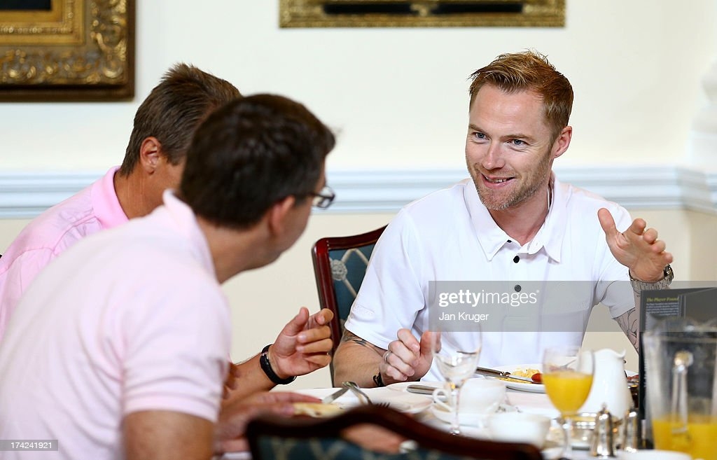 Ronan Keating enjoy breakfast in the Ballroom with other competitors during the Gary Player Invitational Europe 2013 at Wentworth Golf Club on July 22, 2013 in Virginia Water, England.