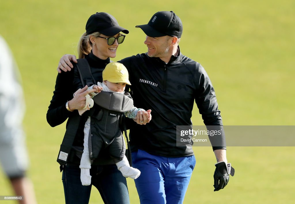 Ronan Keating of Ireland the musician greets his wife Storm Keating and their baby boy Cooper on the ninth hole during the third round of the 2017 Alfred Dunhill Links Championship on the Kingsbarns Golf Links on October 7, 2017 in Kingsbarns, Scotland.