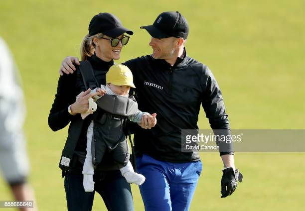Ronan Keating of Ireland the musician greets his wife Storm Keating and their baby boy Cooper on the ninth hole during the third round of the 2017...