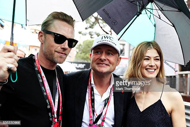 Ronan Keating singer and Rosamund Pike actor on the grid during the Monaco Formula One Grand Prix at Circuit de Monaco on May 29 2016 in MonteCarlo...