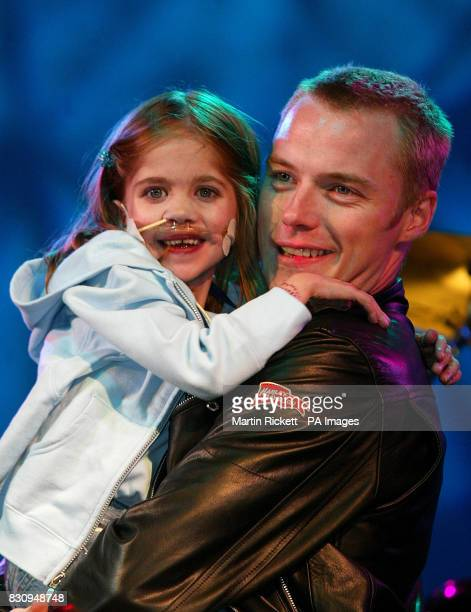 Ronan Keating switches on the Blackpool Illuminations with sixyearold Kirsty Howard Kirsty who was born with her heart back to front was watched by...