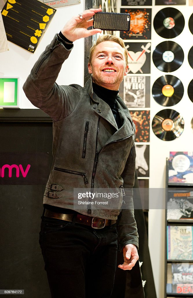 <a gi-track='captionPersonalityLinkClicked' href=/galleries/search?phrase=Ronan+Keating&family=editorial&specificpeople=201657 ng-click='$event.stopPropagation()'>Ronan Keating</a> takes a selfie as he meets fans and signs copies of his new album 'Time Of My Life' at HMV Manchester on February 12, 2016 in Manchester, England.