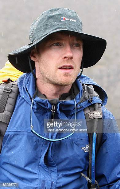 Ronan Keating treks into camp in the rain on the fifth day of The BT Red Nose Climb of Kilimanjaro on March 5 2009 near Arusha Tanzania Celebrities...