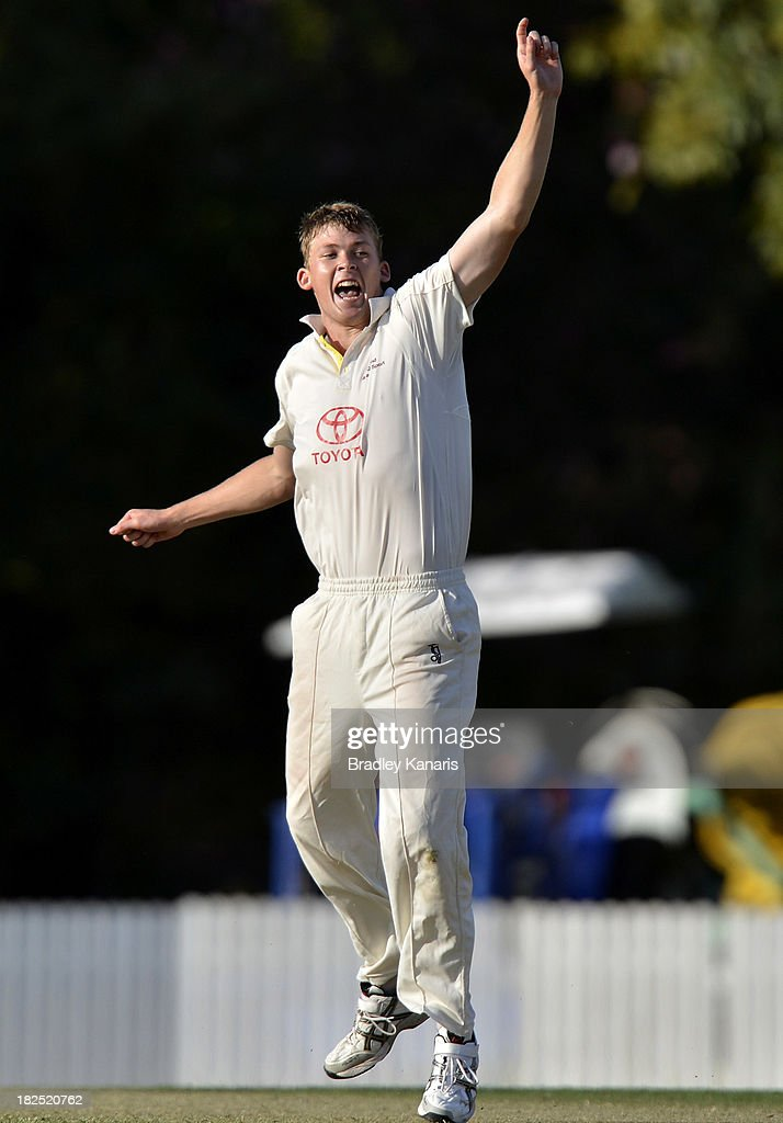 Ronan McDonald of Queensland celebrates after taking the wicket of Ian Holland during day one of the Futures League match between Queensland and Victoria at Allan Border Field on September 30, 2013 in Brisbane, Australia.