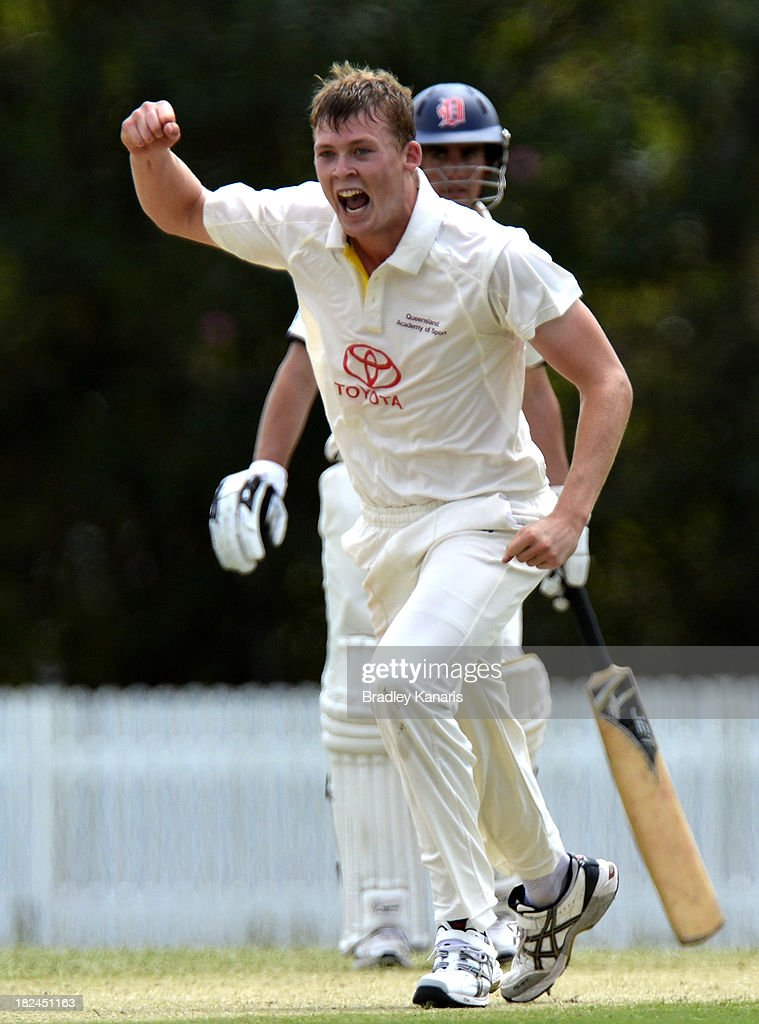 Ronan McDonald of Queensland celebrates taking the wicket of Tom Stray of Victoria during day one of the Futures League match between Queensland and Victoria at Allan Border Field on September 30, 2013 in Brisbane, Australia.