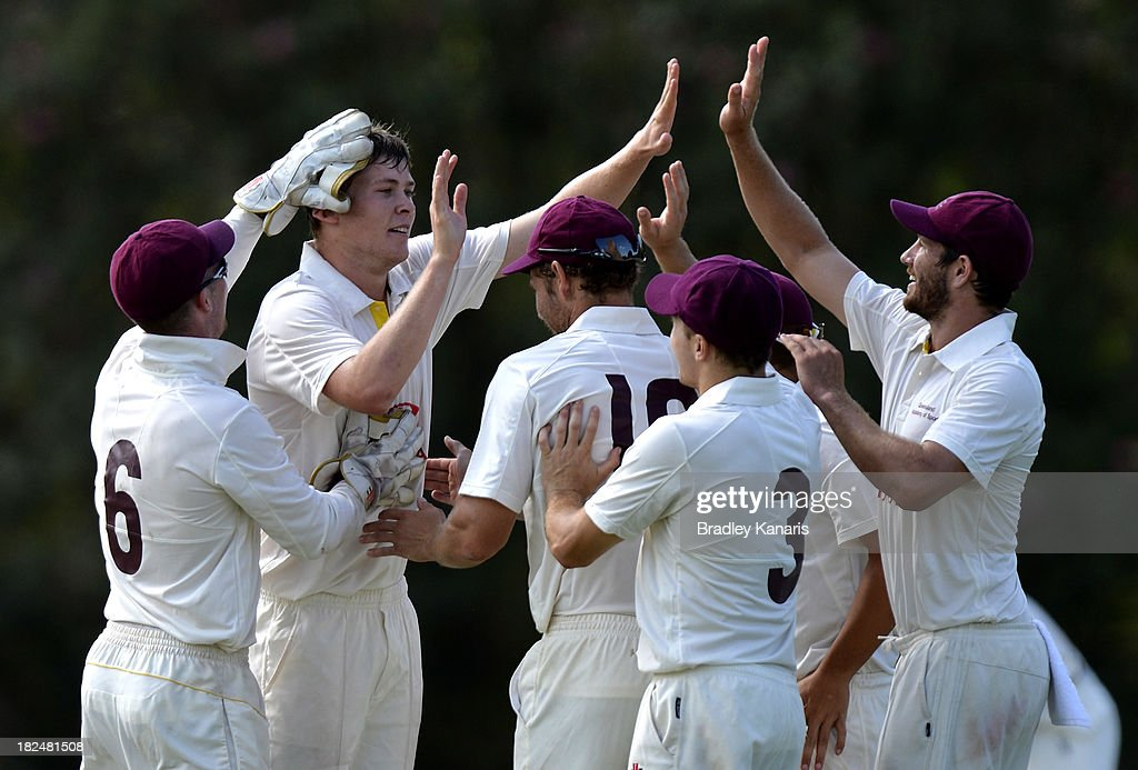 Ronan McDonald of Queensland celebrates with team mates after taking the wicket of Soloman Mire of Victoria during day one of the Futures League match between Queensland and Victoria at Allan Border Field on September 30, 2013 in Brisbane, Australia.