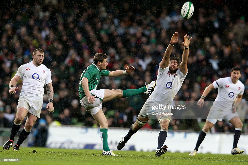Ronan O'Gara of Ireland clears the ball downfield as Geoff Parling of England closes in during the RBS Six Nations match between Ireland and England at Aviva Stadium on February 10, 2013 in Dublin, Ireland.