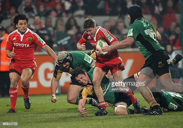 Ronan O'Gara of Munster breaks through during the Heineken Cup game between Munster and Northampton Saints at Thomond Park on January 22 2010 in...