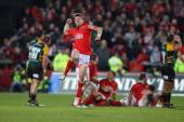Ronan O'Gara of Munster celebrates after kicking the last minute match winning drop goal during the Heineken Cup match between Munster and...
