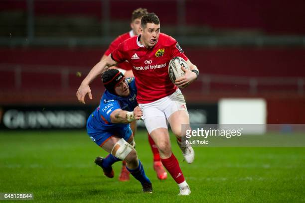 Ronan O'Mahony of Muster tackled by Will Boyde of Scarlets during the Guinness PRO12 Round 16 match between Munster Rugby and Scarlets at Thomond...